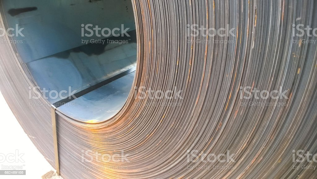 Steel sheets rolled up into rolls. Export Steel. Packing of stee royalty-free stock photo