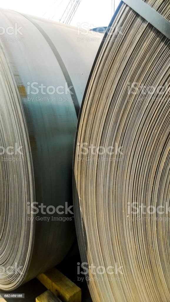 Steel sheets rolled up into rolls. Export Steel. Packing of stee foto de stock royalty-free