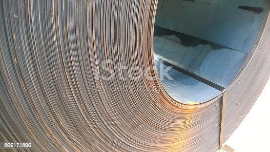 518201052istockphoto Steel sheets rolled up into rolls. Export Steel. Packing of stee 869171896