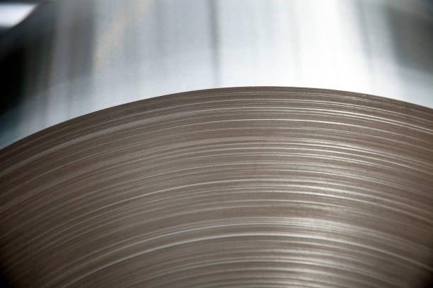 Steel sheets rolled up into rolls. Steel sheets rolled up into rolls. aluminum stock pictures, royalty-free photos & images