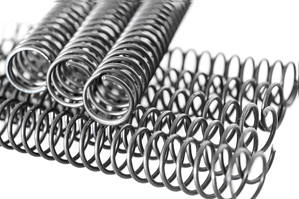 steel springs steel springs on white background amortize stock pictures, royalty-free photos & images