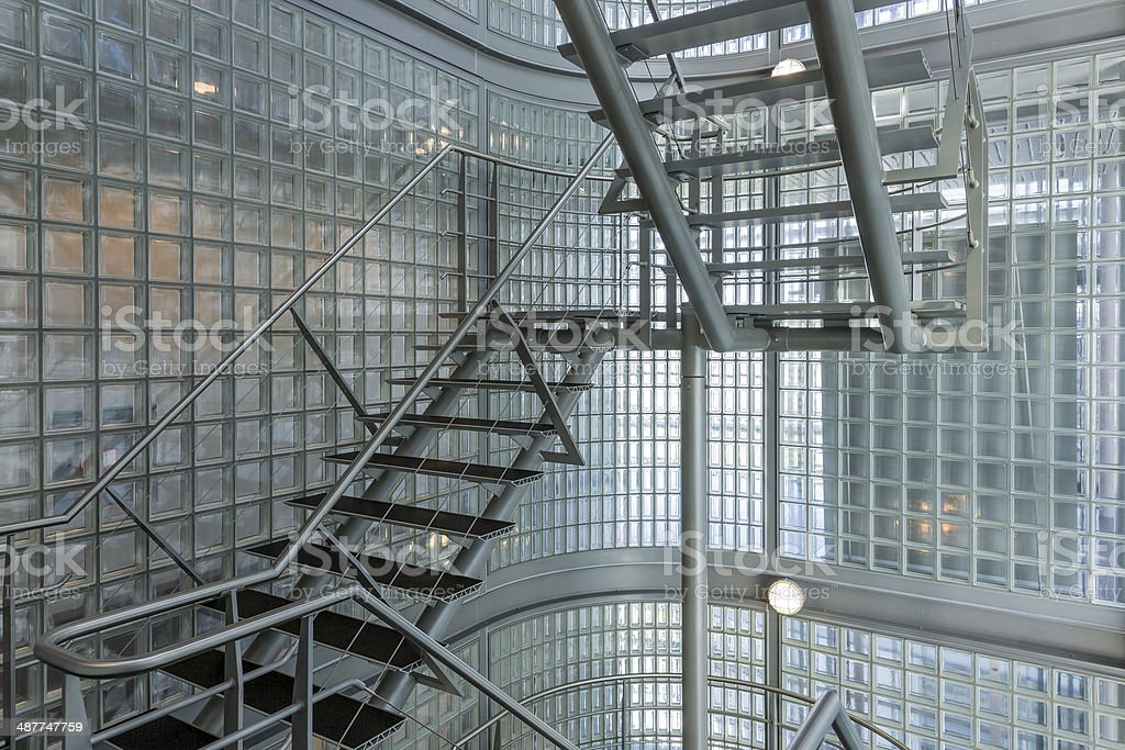 Steel stairway in a modern office building stock photo