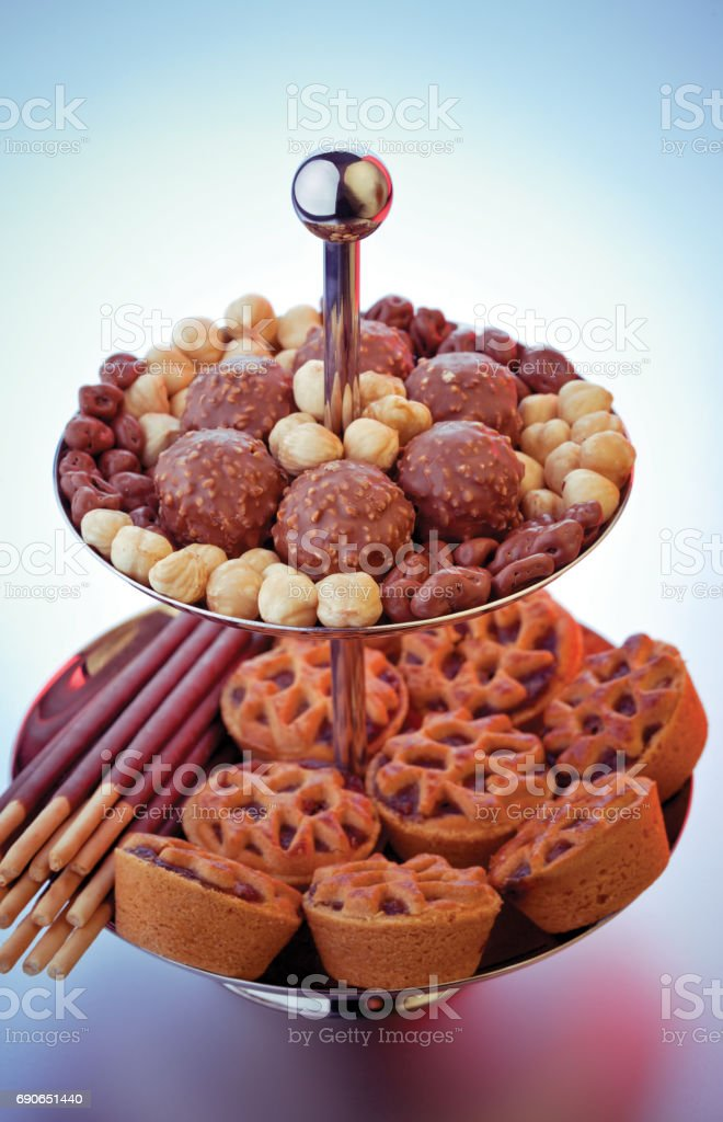 Steel stand full of sweets stock photo