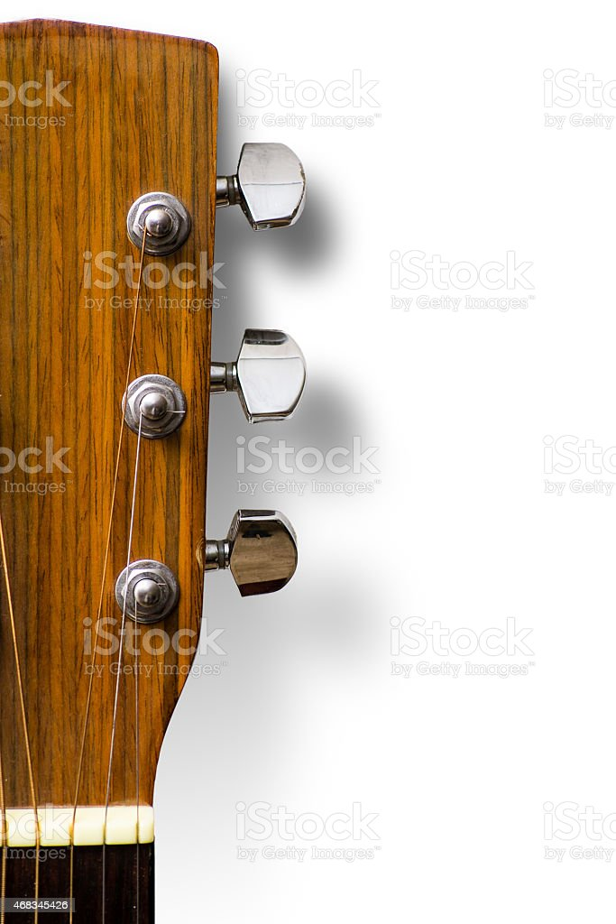 Steel String Acoustic Guitar Headstock against a White Background stock photo
