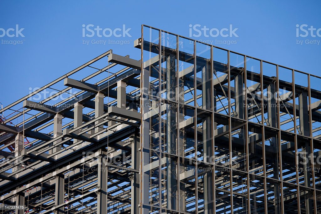 Steel structure from a building under construction on blue sky stock photo