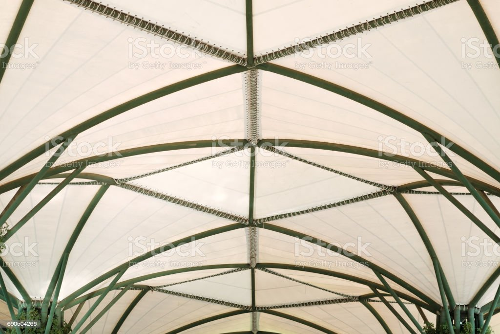 Steel structure with canvas roof background. stock photo