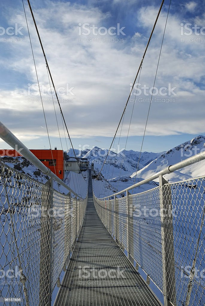 steel suspension bridge high in the mountains royalty-free stock photo