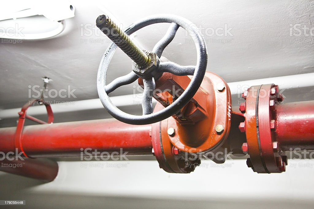 Steel water pipelines in building royalty-free stock photo
