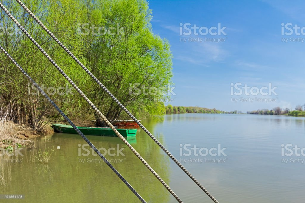 Steel wire rope cables, in background are beached fisherman boat stock photo