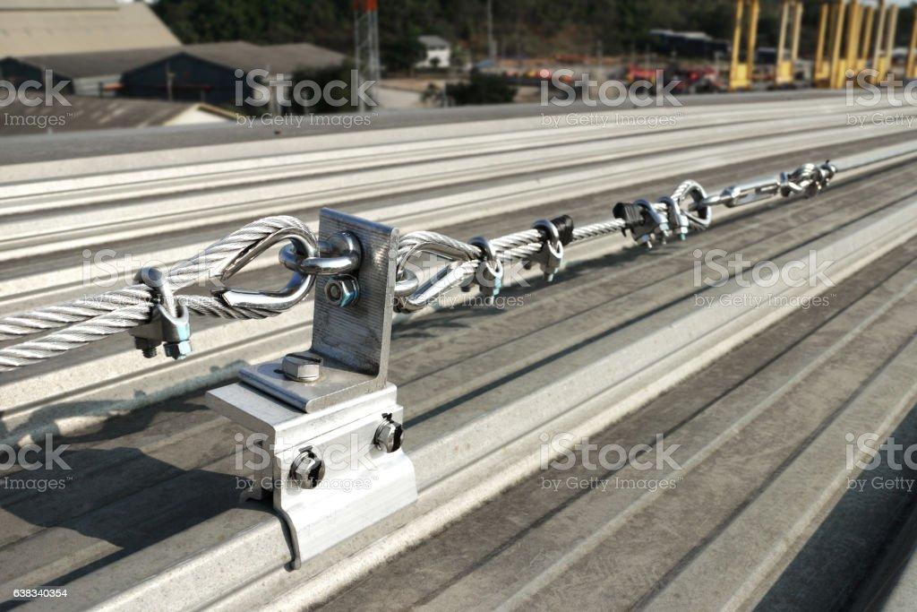 Steel Wire Rope Lifeline on Roof stock photo