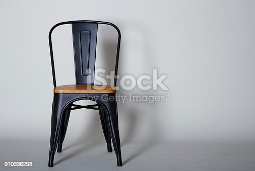 Steel with wood chair on Grey  textured background wall Copy space