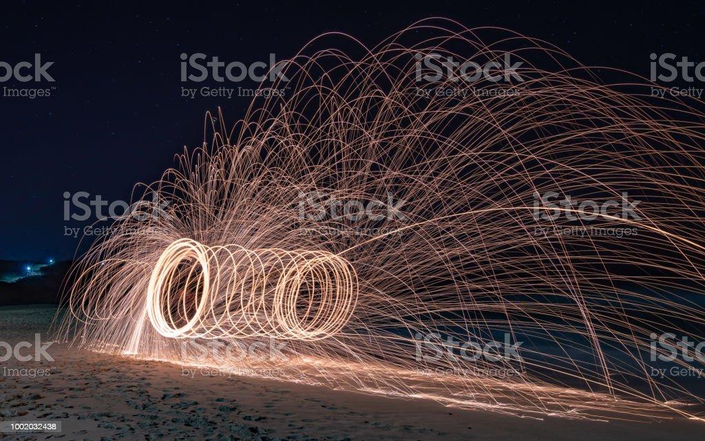 Steel wool fire twirling stock photo