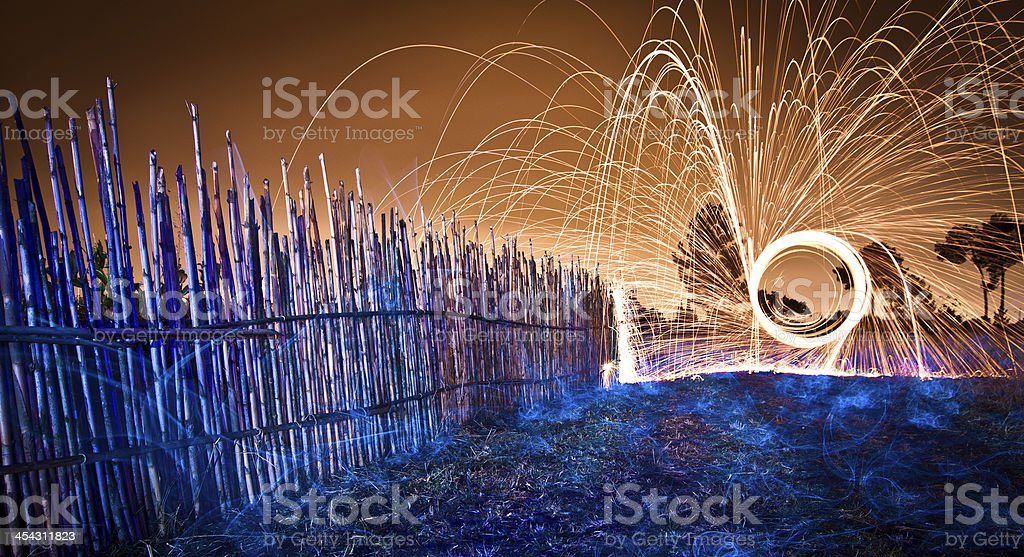Steel wool spinning at the countryside stock photo