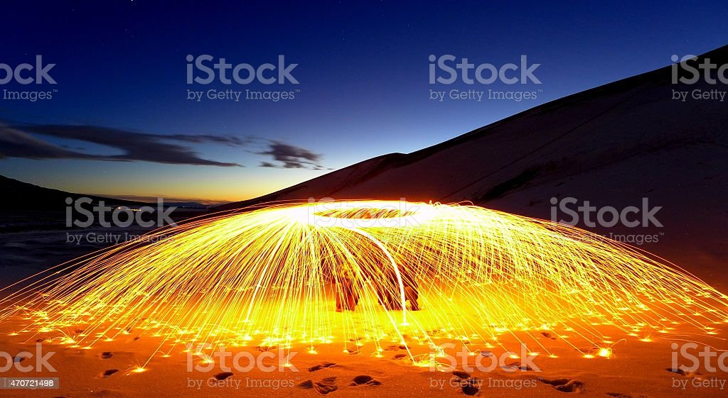 Steel wool spinning during a sunset stock photo