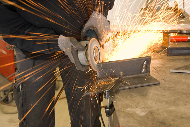 steel worker grinder stock photo