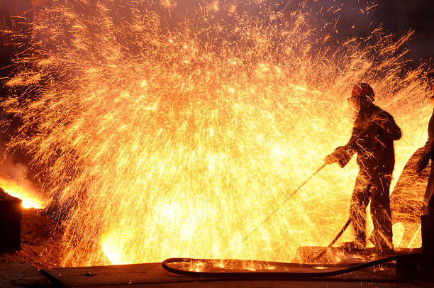steel workers - metallurgy stock photos and pictures