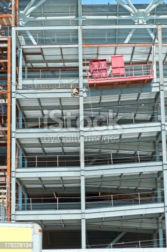Steelwork welding girders at construction site