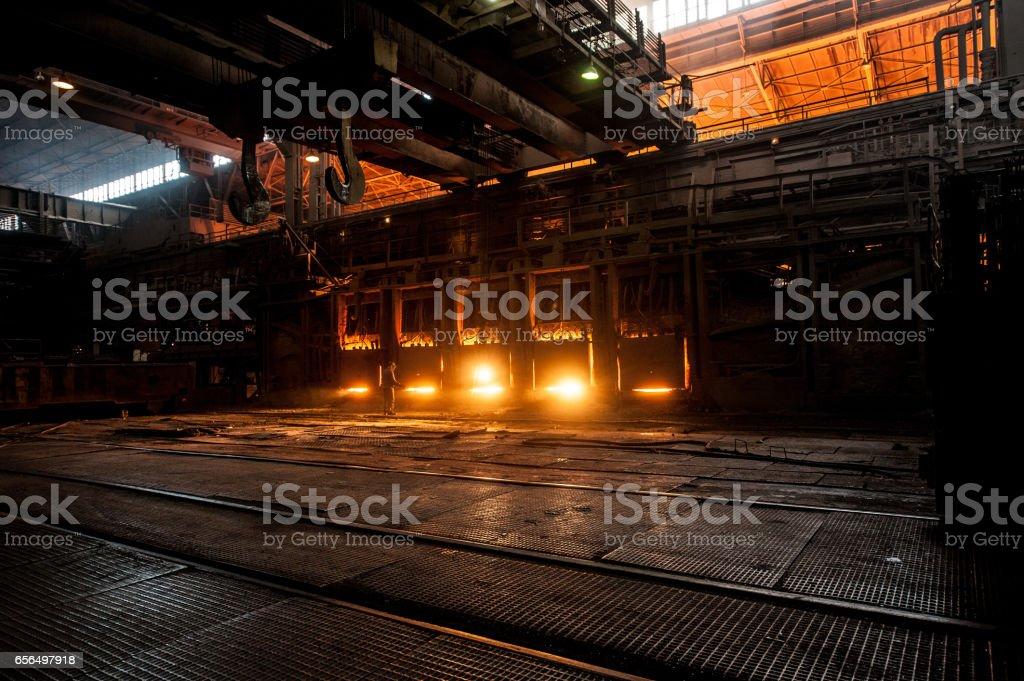 Steelworker near the working open hearth furnace stock photo