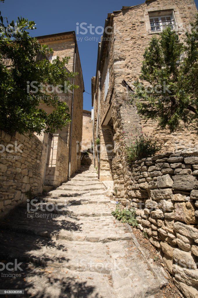 Steep alley with medieval houses in Gordes. Provence, France stock photo