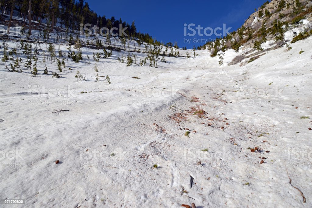 Steep angled slopes on mountain showing avalanche terrain, a major risk for skiing, hiking and climbing on mountains in fresh snow stock photo
