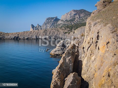istock Steep beautiful mountains and azure waters of the Black Sea off the coast of the village of Novy Svet in the Crimea. Golitsyn or Falcon trail. 1078058354