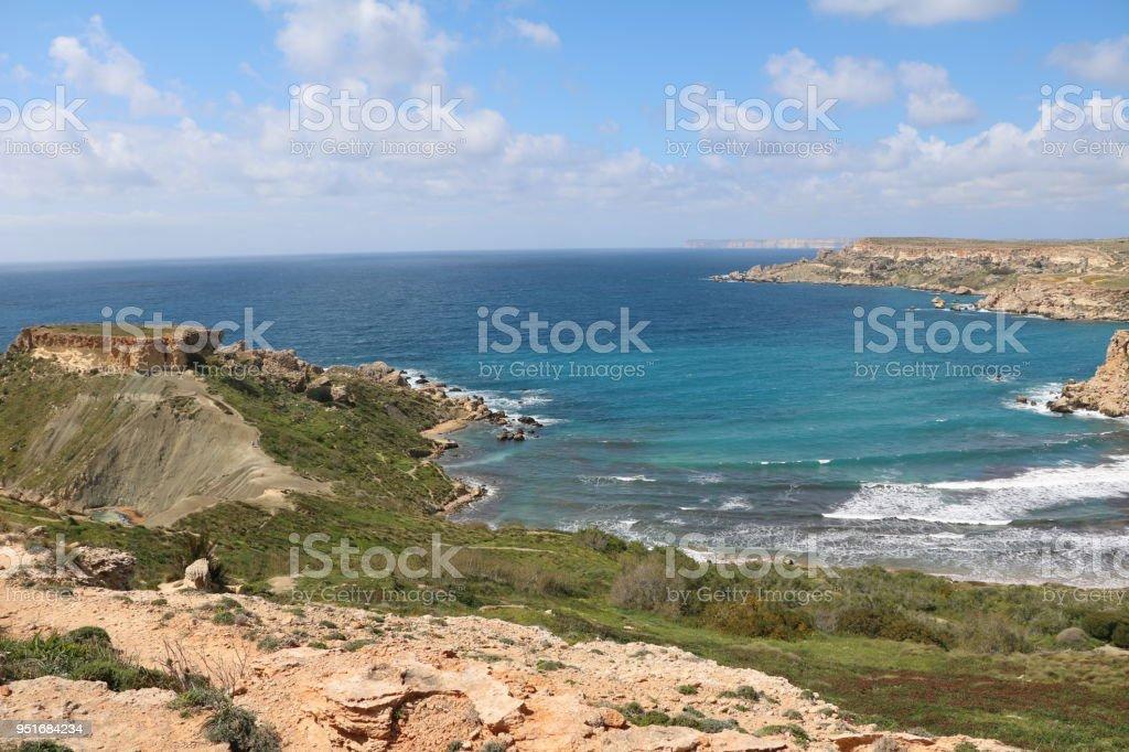 Steep Coastline around Ghajn Tuffieha Bay at the Mediterranean Sea in Malta stock photo