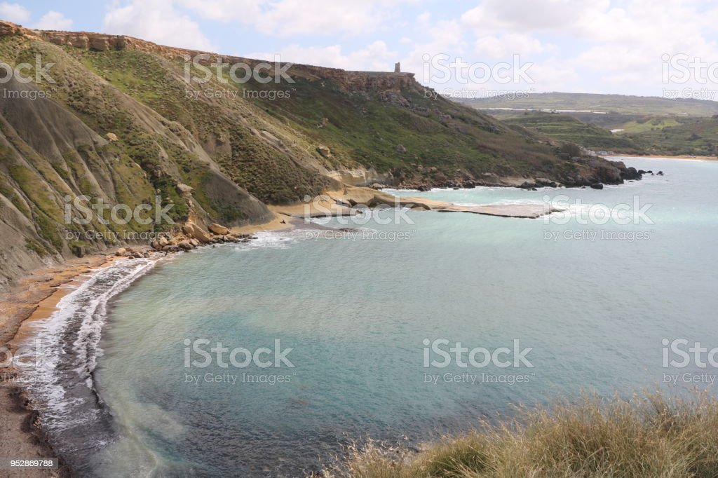 Steep Coastline around Gnejna Bay at the Mediterranean Sea in Malta stock photo