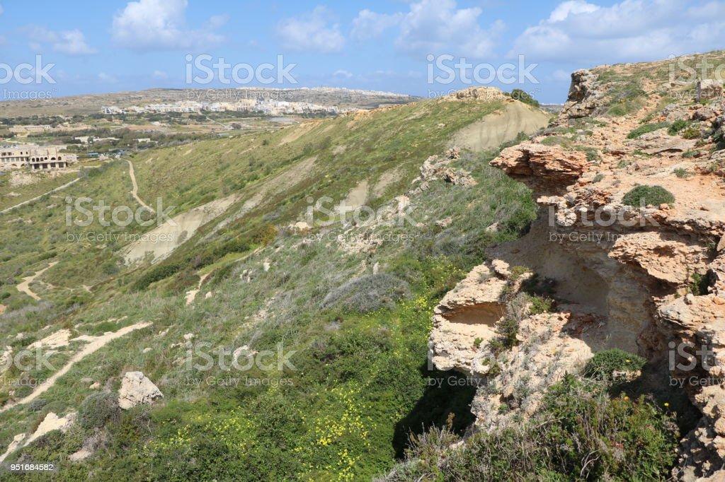 Steep Coastline around Golden Bay and Ghajn Tuffieha Bay at Mediterranean Sea Malta stock photo