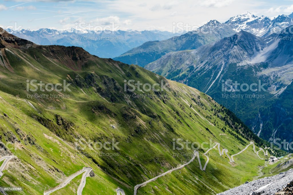 Steep descent of mountain road Stelvio pass stock photo
