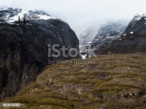 istock Steep Glacially Polished Cliffs at Tracy Arm Fjord, Southeast Alaska 980676292
