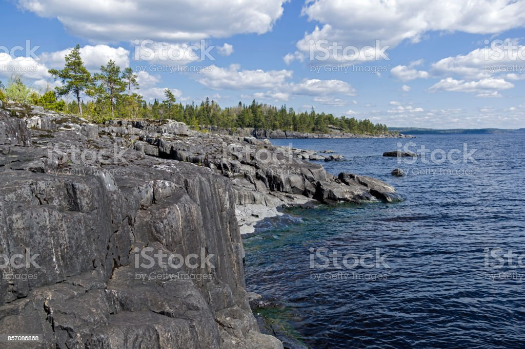 Steep granite shores of Lake Ladoga. Karelia, Russia. stock photo