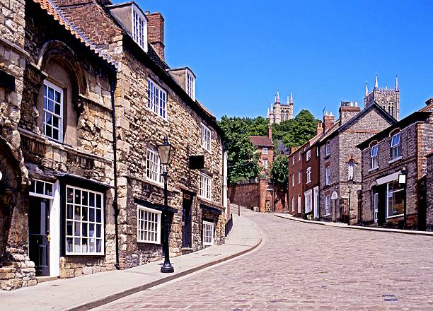 Steep Hill, Lincoln. View of the buildings and shops along Steep Hill, Lincoln, Lincolnshire, England, UK, Western Europe. steep stock pictures, royalty-free photos & images