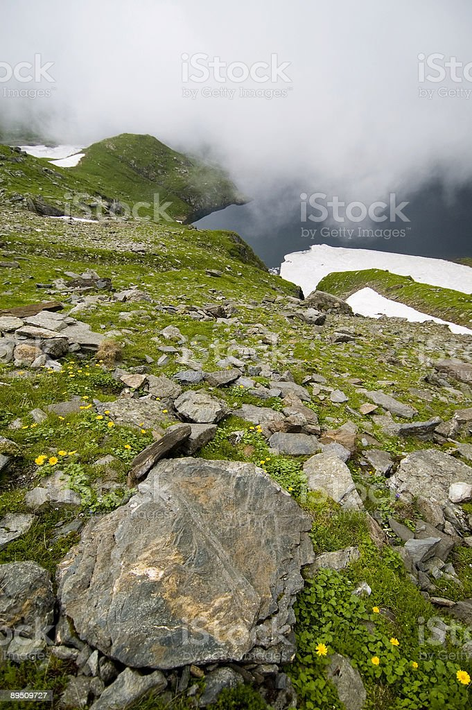 Steep mountain side, Balea Lake, Romania. 免版稅 stock photo