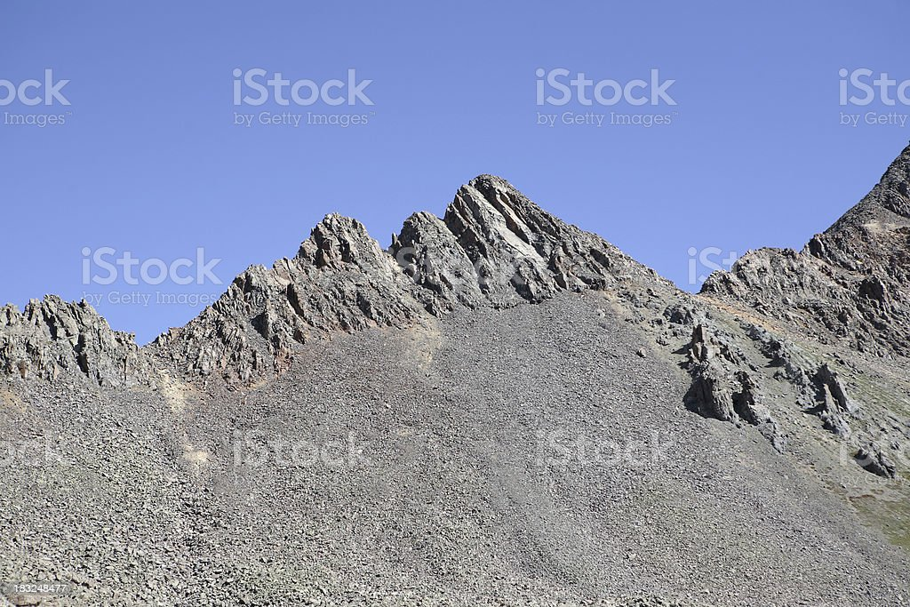steep rocky peak stock photo