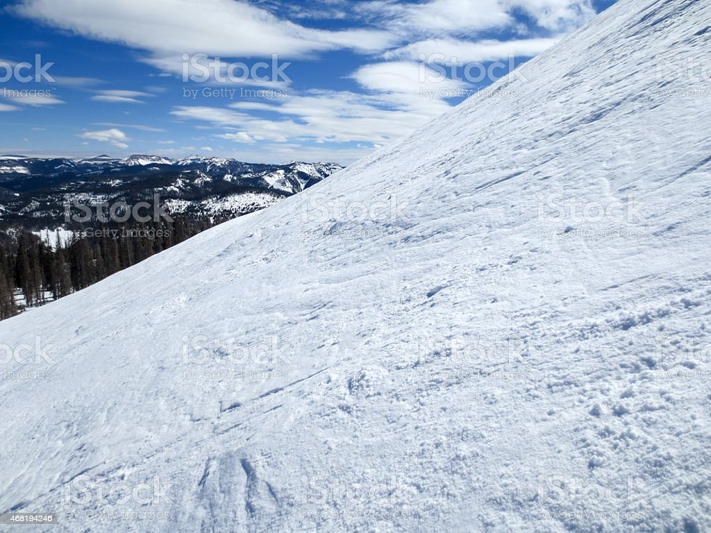 Steep ski slope on a beautiful bluebird day stock photo