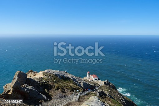 A steep staircase leads past the rocky terrain down to the Point Reyes lighthouse overlooking the Pacific Ocean in Northern California; landscape