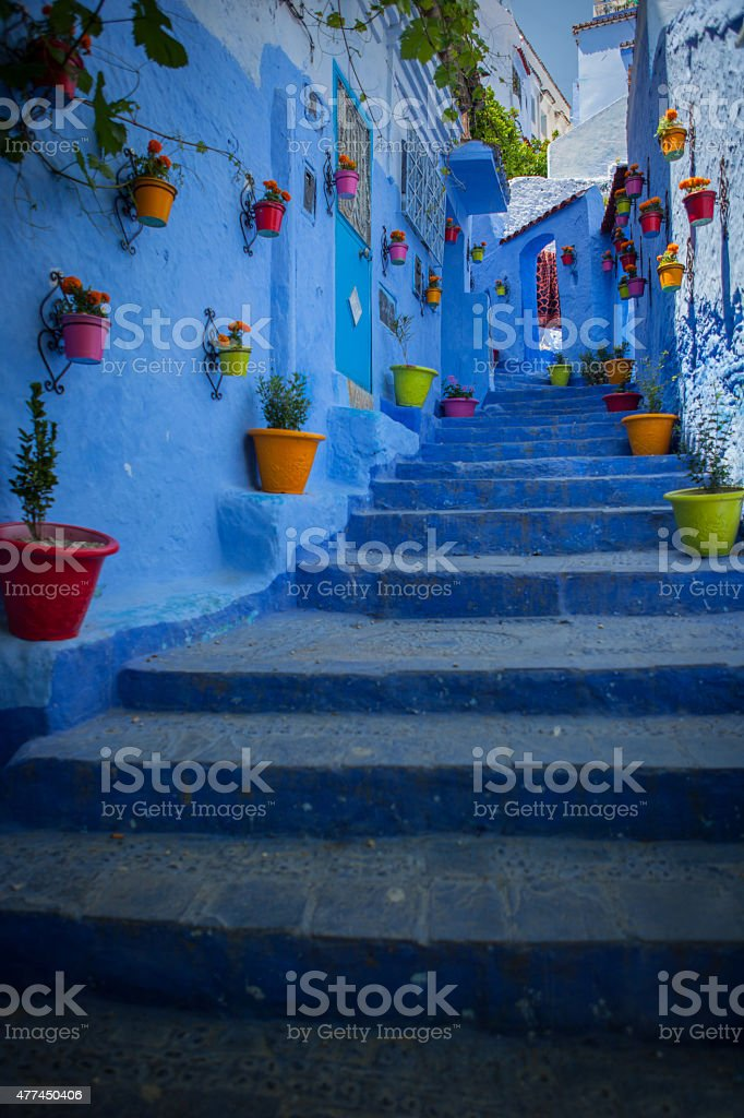 Steep street in Chefchaouen Morocco the blue city stock photo