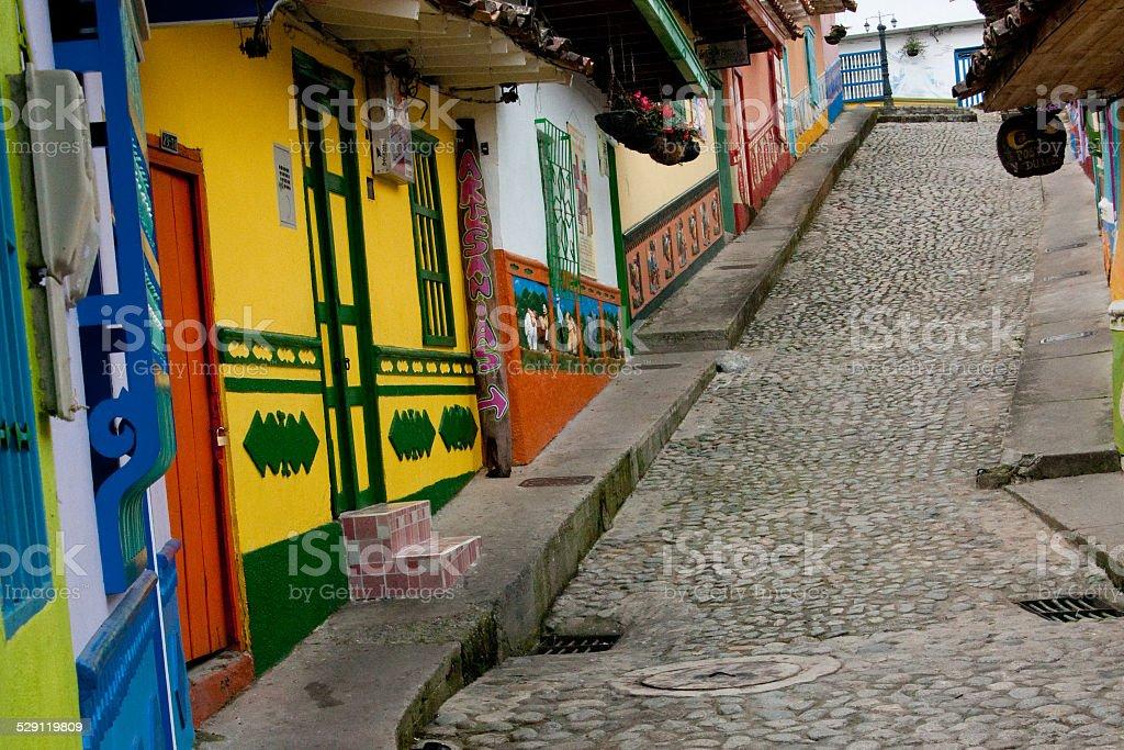 Steep street in Guatape (Colombia) stock photo