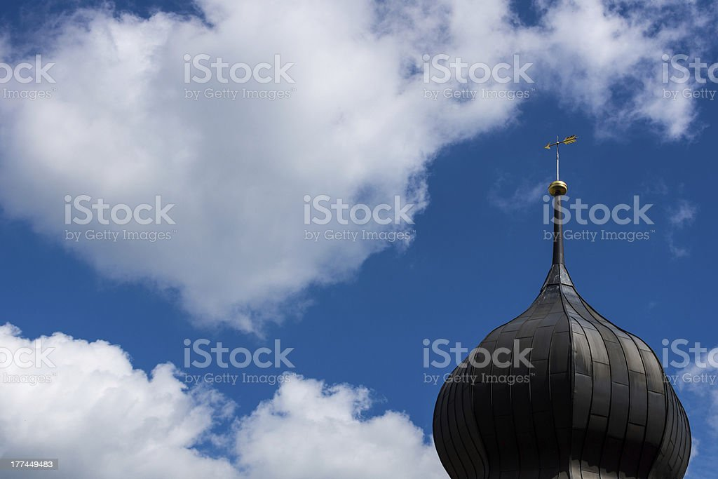Steeple in front of a blue and white sky stock photo