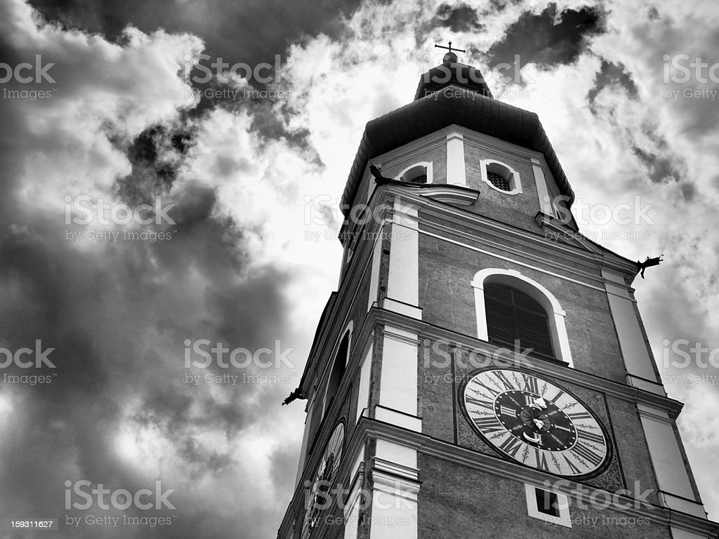 steeple in front of a dark cloudy sky stock photo