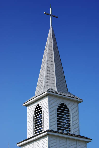 Steeple With A Cross On An Older White Country Church Stock Photo