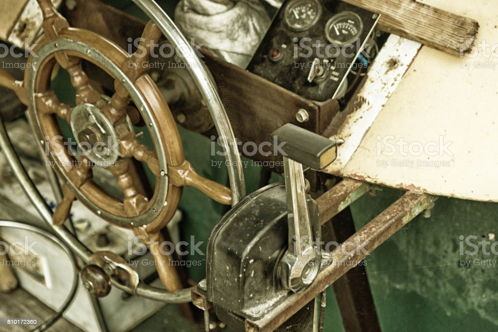 Steering wheel and accelerator on a narrowboat stock photo