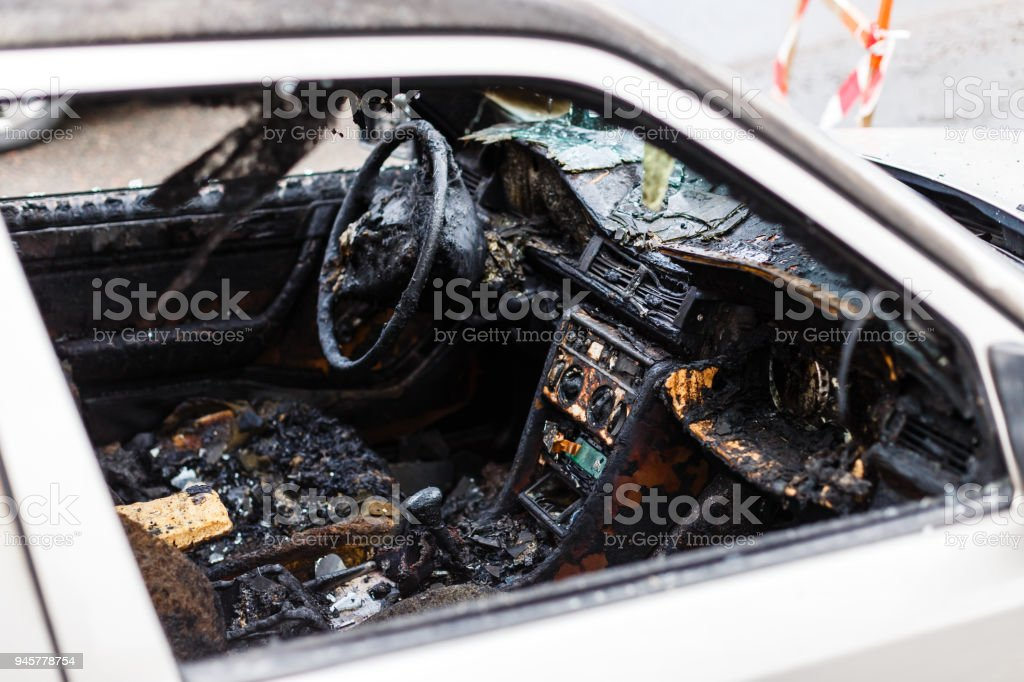 Steering wheel and dashboard of a burnt out car stock photo