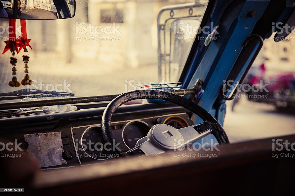 steering wheel and dashboard school bus stock photo