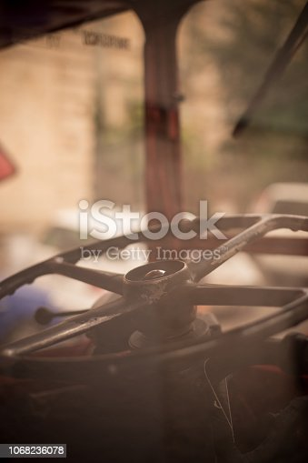 Close up shot of the steering wheel of an old bus.