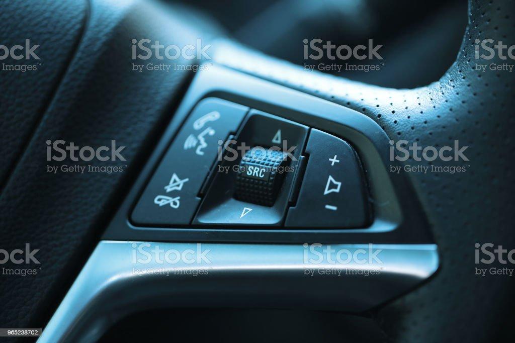 Steering wheel on radio control button royalty-free stock photo