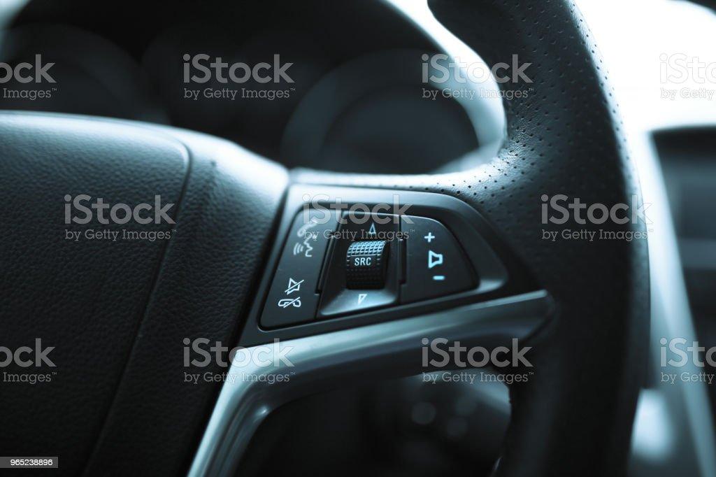 Steering wheel on radio control button zbiór zdjęć royalty-free
