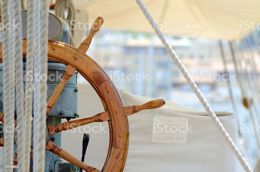Steering wheel on sailboat horizontal shot stock photo