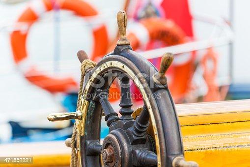 istock Steering wheel on sailing ship 471852221