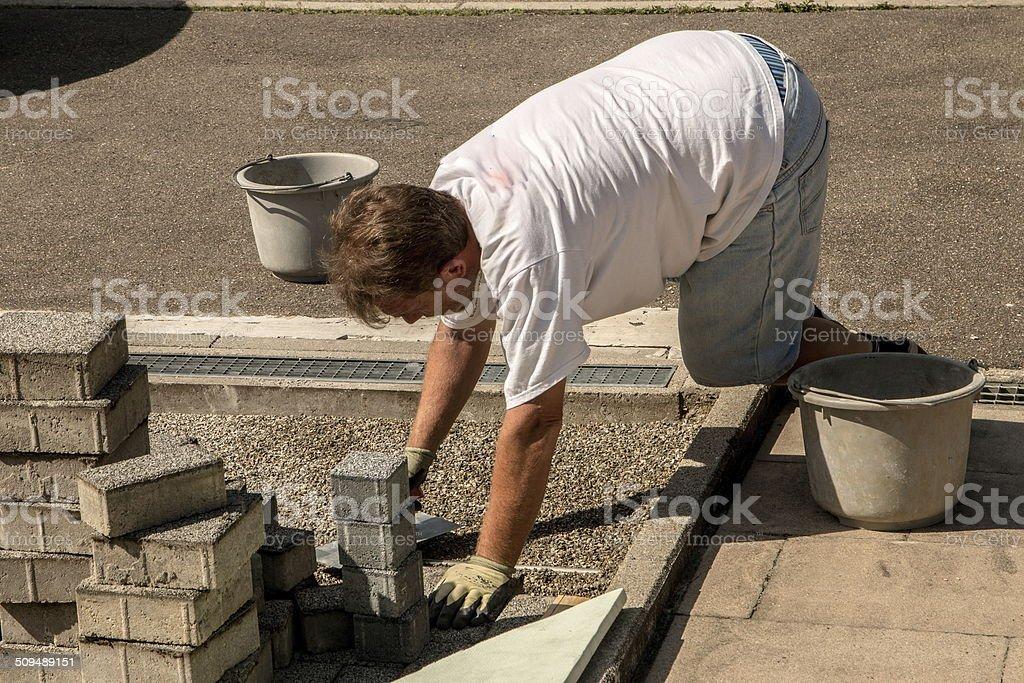 Steine verlegen stock photo